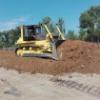 Бульдозер ТМ10 ГСТ10 на строительстве дорог